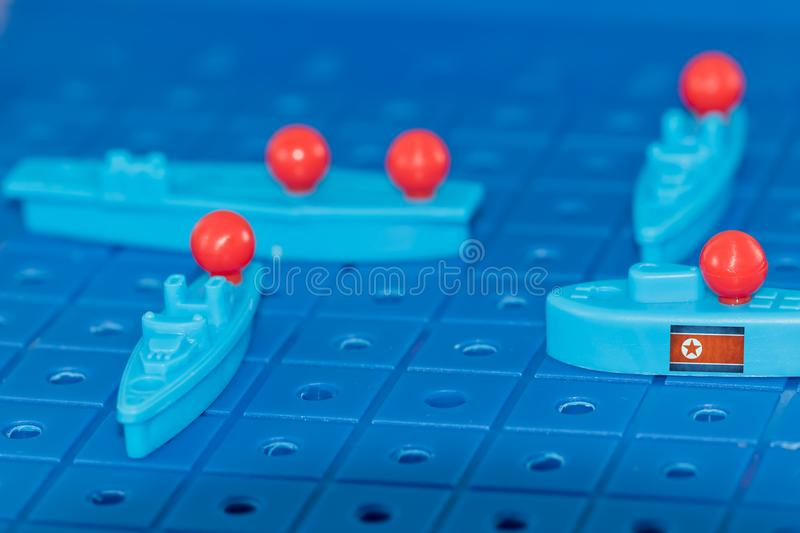North Korean nuclear submarine with a nuclear missile surrounded. By enemies on the Board game battleship royalty free stock images
