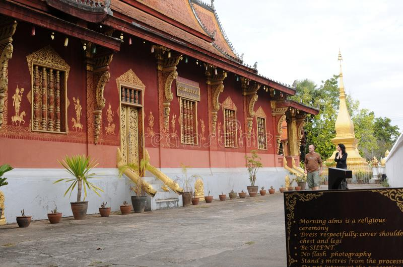 North Laos: Tourist visiting the Vatmay Souvannapoumaram temple in Luang Brabang City stock photo