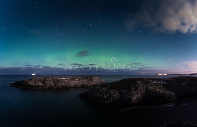 North lights Aurora Borealis seen from Atlantic Ocean road in winter night. Norwegian wintertime royalty free stock image
