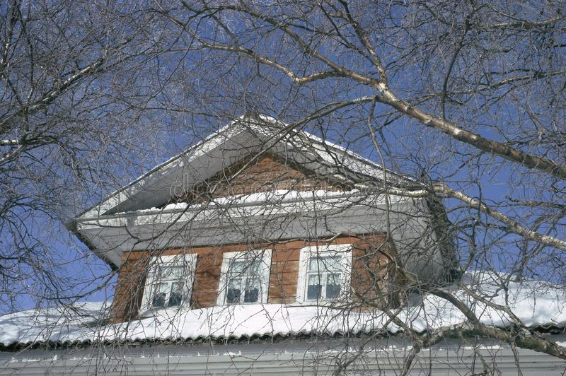 The North loft, a wooden house in the branches of trees on blue sky background stock photo