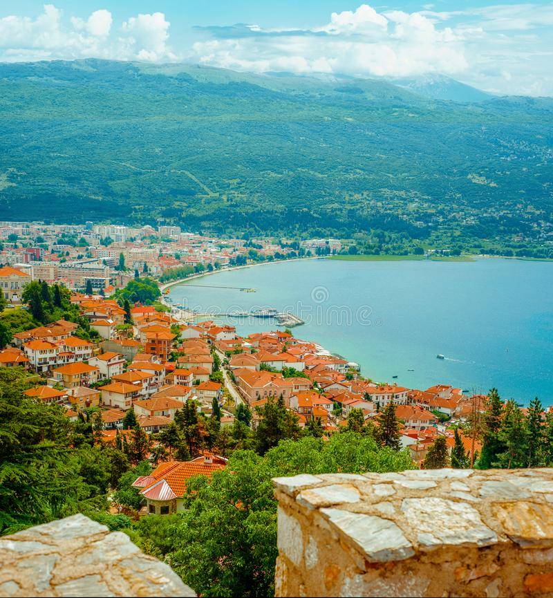 North macedonia. Ohrid. Different buildings and houses with red roofs on lake shore on mountains background.  royalty free stock photography