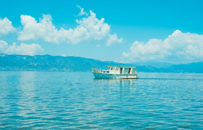 North macedonia. Ohrid. White boat on Ohrid lake in sunny day. Horizontal photo.  stock images