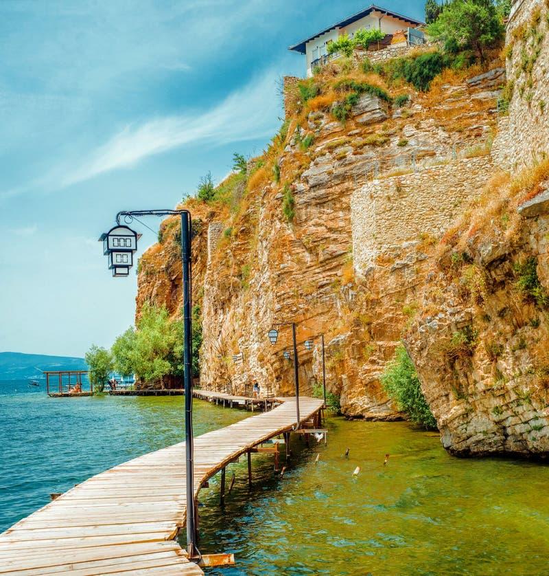 North macedonia. Ohrid. Wooden platform along ohrid lake at the foot of the mountain.  stock photography