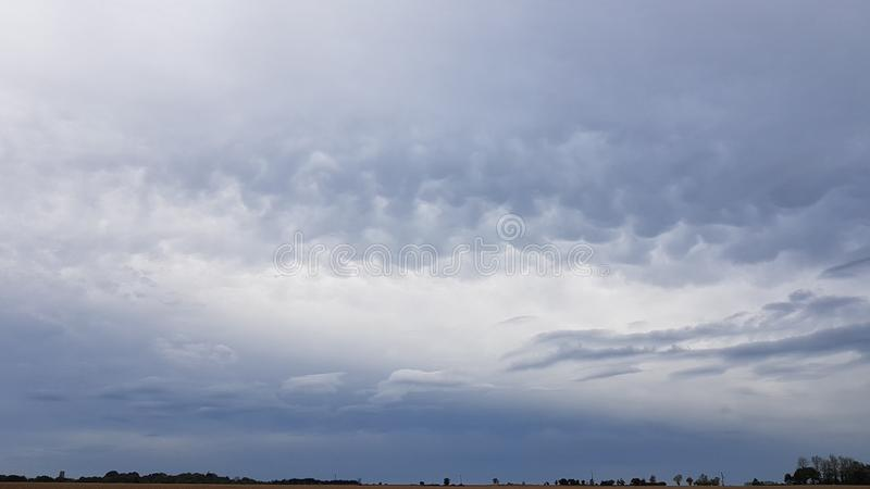 Amazing Autumn North Norfolk Cloudy Sky. North Norfolk Autumn sky. Amazing clouds over flat landscape with tree line royalty free stock images