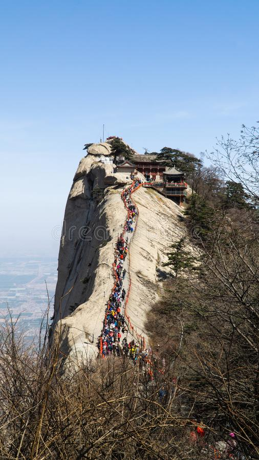 North peak - one of five main peaks of famous sacred taoist mountain Mount Huashan, popular touristic place, China. North peak - one of five main peaks of famous stock photography