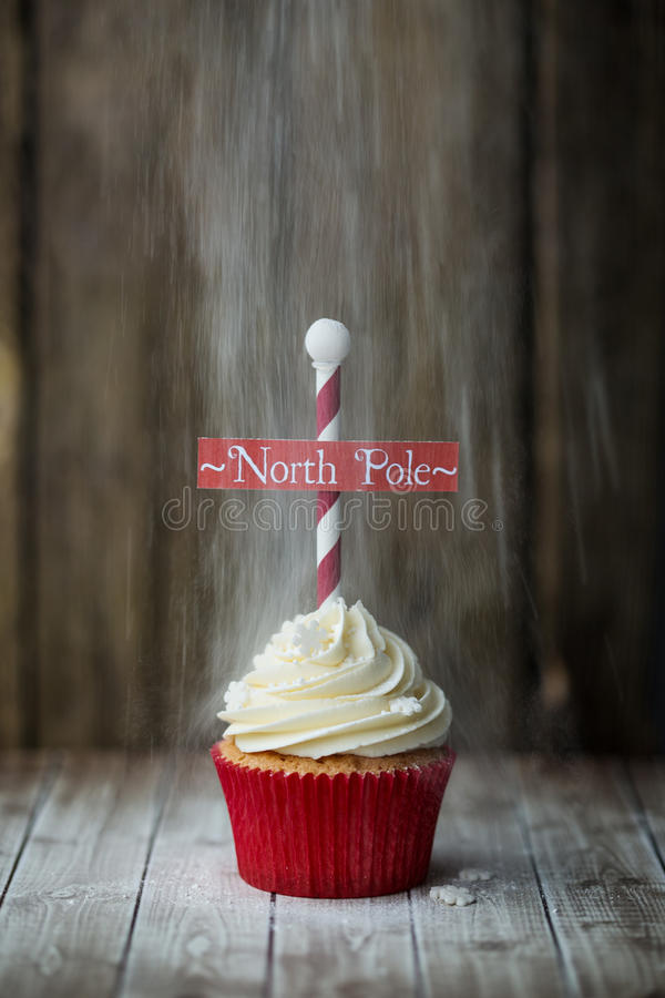 North Pole cupcake. Christmas North Pole cupcake with a dusting of powdered sugar royalty free stock photos