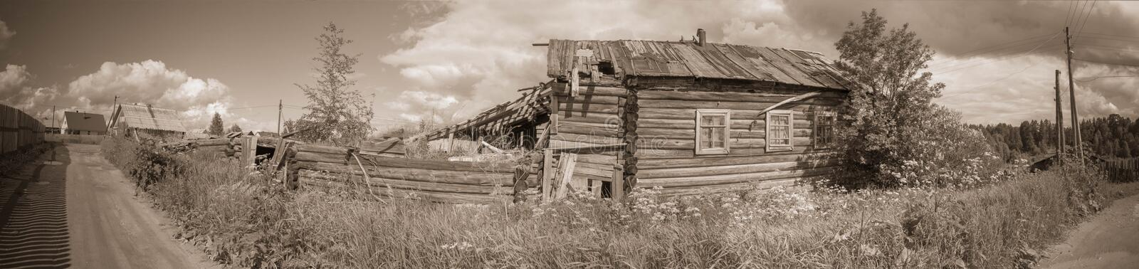 North Russian village Isady. Summer day, Emca river, old cottages on the shore, old wooden bridge. Abandoned building. North Russian village Isady. Summer day stock photo