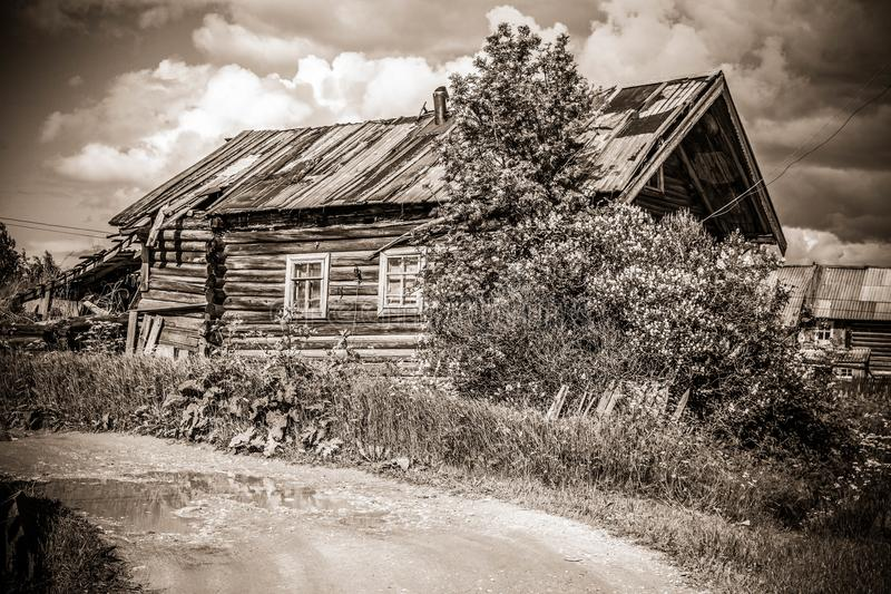 North Russian village Isady. Summer day, Emca river, old cottages on the shore, old wooden bridge. Abandoned building. North Russian village Isady. Summer day royalty free stock photos