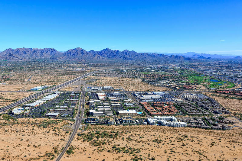 North Scottsdale, Arizona. Growth in North Scottsdale, Arizona as viewed from above with the McDowell Mountains on the horizon stock image