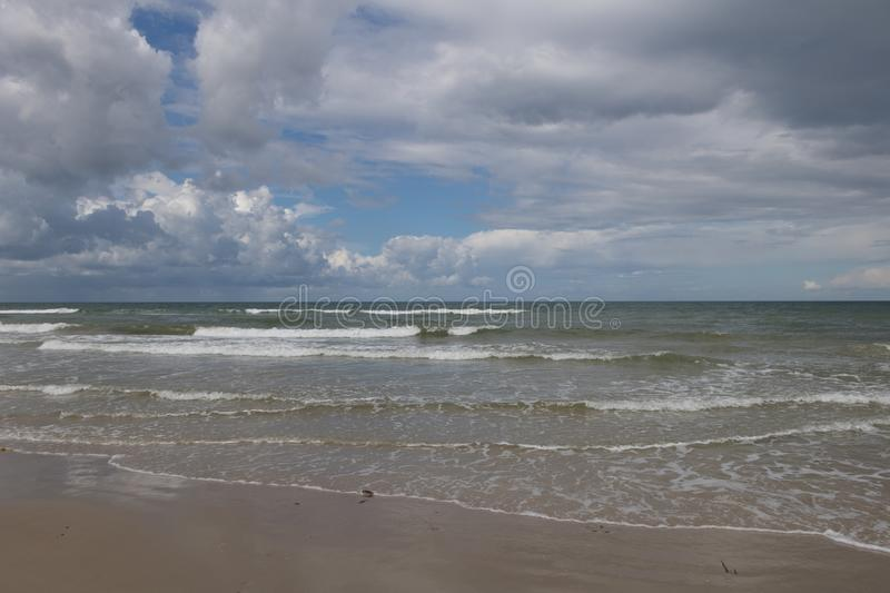 The beach of the North Sea seen from Blokhus, Denmark. The North Sea seen from the seaside town of Blokhus, Jutland, Denmark with dramatic clouds. The beach of stock image