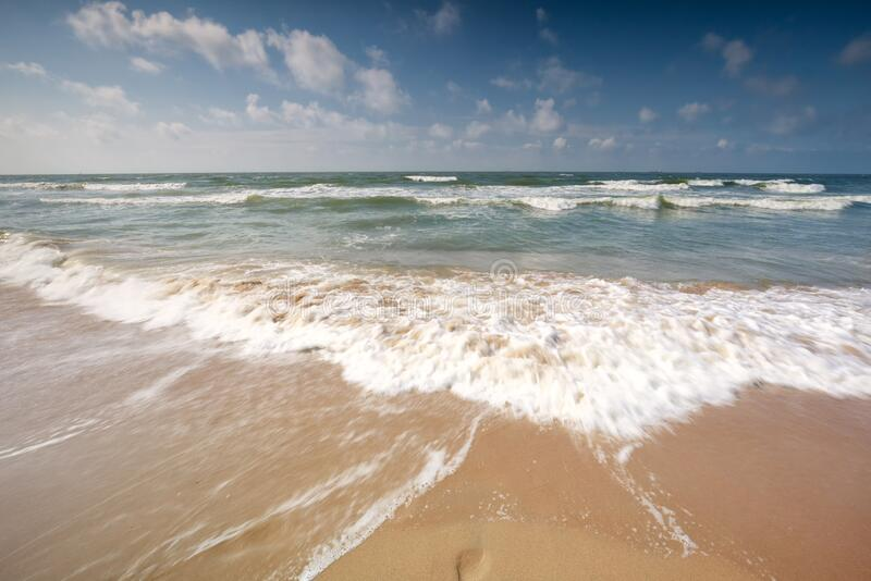 North sea waves on beach royalty free stock photography