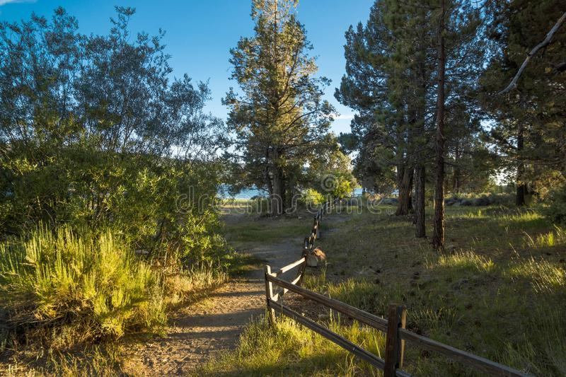 North Shore, Big Bear Lake, California, Pathway. Split Rail Fence, Summer Afternoon stock photo