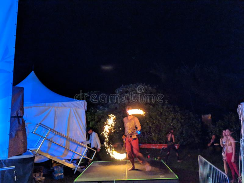 Fire Spinning on stage during night royalty free stock images