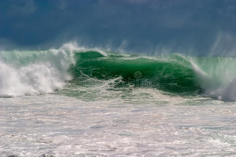 North Shore waves in Kauai breaking along the seashore. On a windy day in late fall stock image