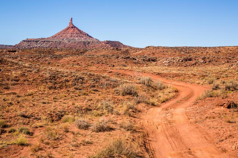 North Sixshooter Peak and dirt road in Indian Creek, Bears Ears stock photos