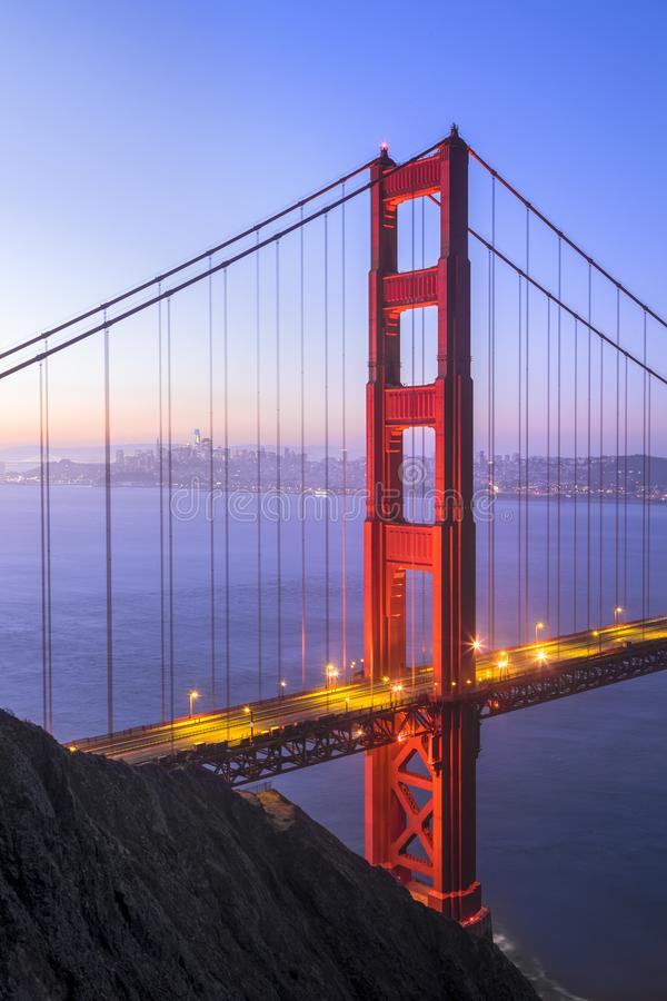 Golden Gate North Tower - San Francisco Bay California. The north tower of the iconic Golden Gate Bridge stands tall backed by the city of San Francisco just royalty free stock images