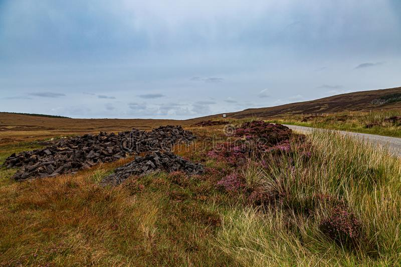 A North Uist Rural View with Peat Briquettes in the Countryside royalty free stock image
