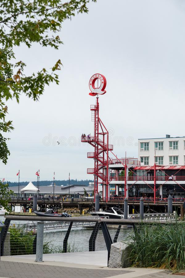 NORTH VANCOUVER, BC, CANADA - JUNE 9, 2019: The boardwalk area near the shipyards at Lonsdale Quay public market. stock photos