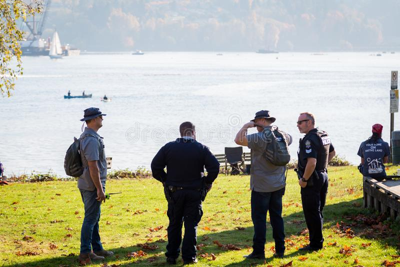NORTH VANCOUVER, BC, CANADA - OCT 28, 2017: North Vancouver RCMP standing watch over the Kinder Morgan pipeline protest royalty free stock photography
