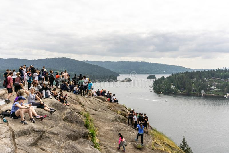 NORTH VANCOUVER, CANADA - May 21, 2018: people on top of Quarry Rock lookout on cloudy spring day.  stock photos
