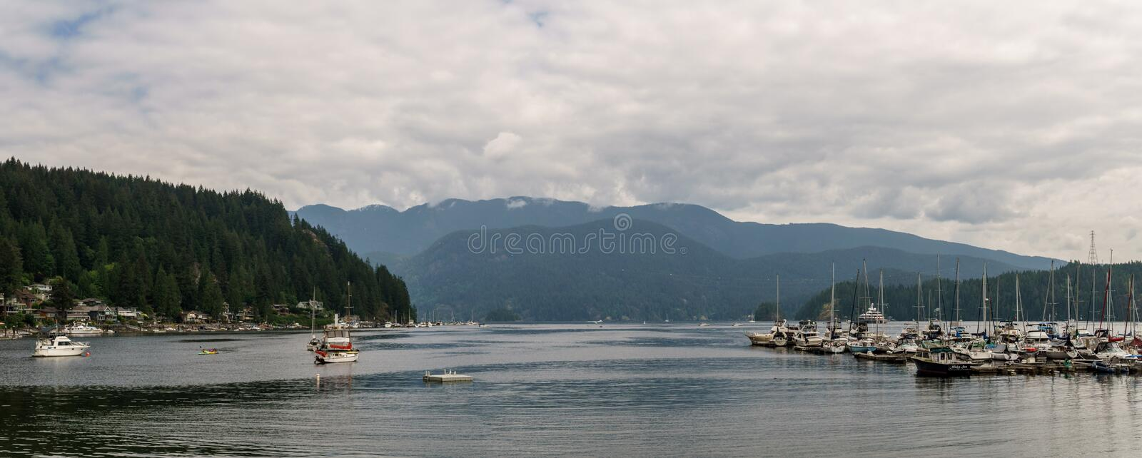 NORTH VANCOUVER, CANADA - May 21, 2018: View of Indian Arm with Yachts in Deep Cove.  stock photos