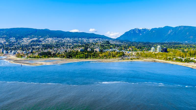 North Vancouver and West Vancouver in British Columbia, Canada. North Vancouver and West Vancouver across Burrard Inlet, the entrance into Vancouver harbor royalty free stock photo