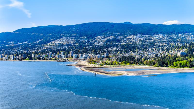 North Vancouver and West Vancouver in British Columbia, Canada. North Vancouver and West Vancouver across Burrard Inlet, the entrance into Vancouver harbor stock photos