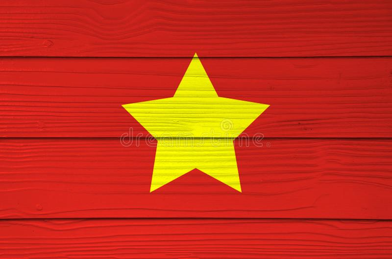 North Vietnam 1945 to1955 flag color painted on Fiber cement sheet wall background. Flag of Democratic Republic of Vietnam yellow star on red stock photography