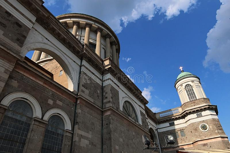 North wall of Primatial Basilica of the Blessed Virgin Mary Assumed Into Heaven and St Adalbert, main dome and side tower visible. Summer afternoon, slightly royalty free stock photo