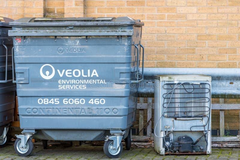 Northampton UK December 09, 2017: Veolia Enviromental Services logo on Waste Commercial Bin with recycled fridge freezer. In Brackmills Industrial Estate stock images