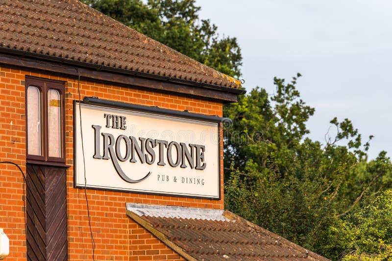Northampton UK July 21 2018: The Ironstone Pub logo sign post in Hunsbury royalty free stock photos