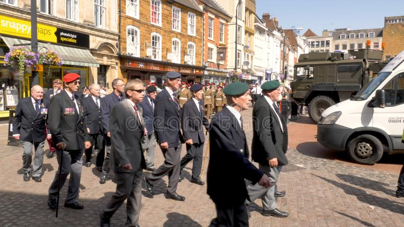 Northampton UK: 29 June 2019 - Armed Forces Day Parade Veterans marching on Abingron Street.  royalty free stock photography