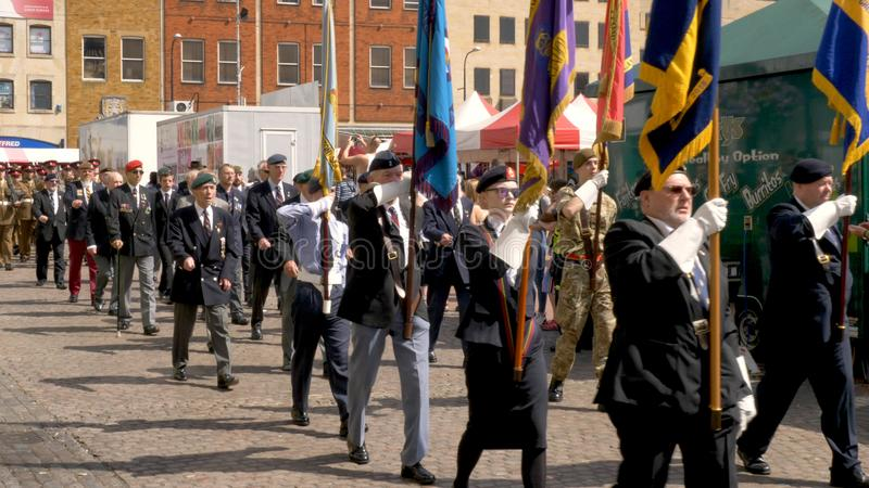 Northampton UK: 29 June 2019 - Armed Forces Day Parade Veterans marching on Market Square.  royalty free stock photography