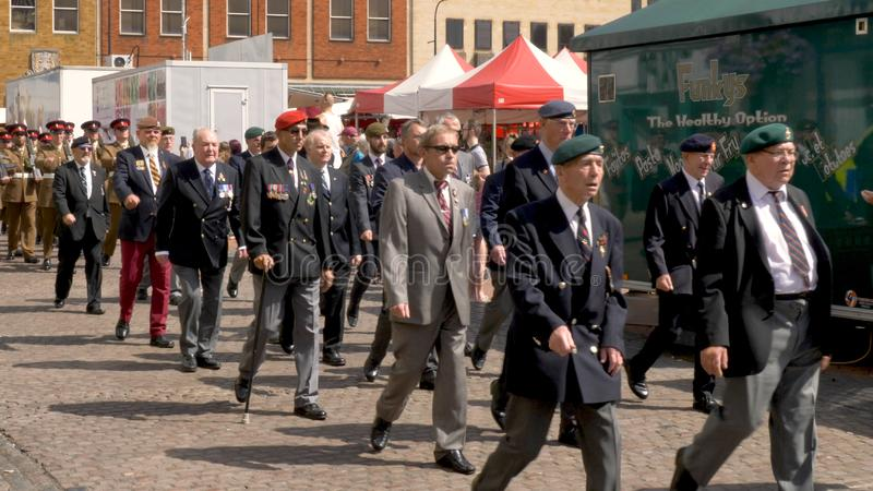 Northampton UK: 29 June 2019 - Armed Forces Day Parade Veterans marching on Market Square.  stock photos