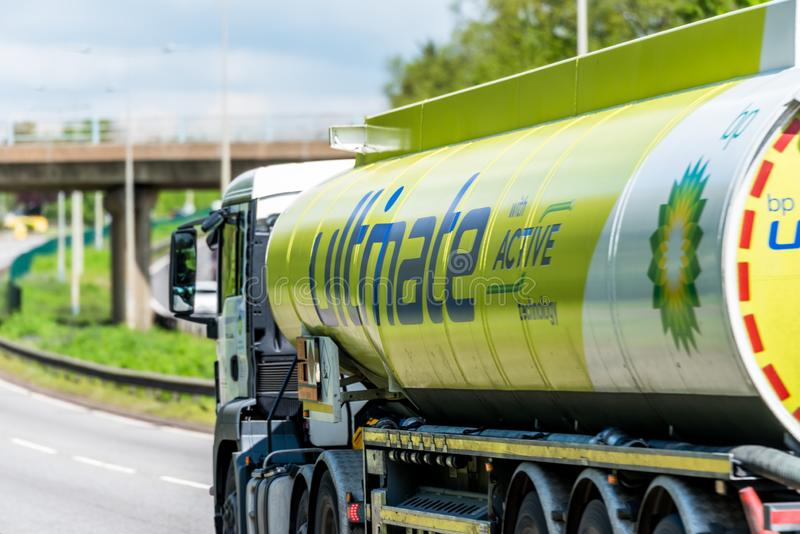 Northampton, UK - May 10th 2019: british petroleum tanker lorry truck on uk motorway in fast motion royalty free stock photos