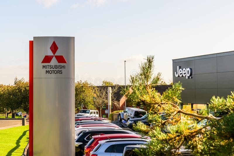 Northampton UK October 3, 2017: Mitsubishi Motors and Jeep logo sign stand Northampton industrial estate.  stock images
