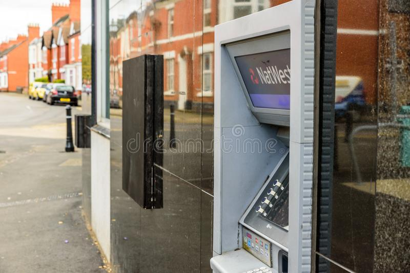 Northampton UK October 3, 2017: Natwest bank ATM closed down with wooden board Northampton royalty free stock images