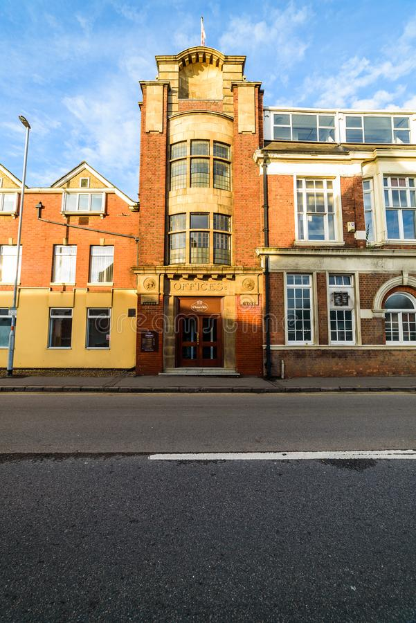 Northampton, UK - Sep 10, 2017: Low angle morning view of Churchs English Shoes Company Office facade royalty free stock photography