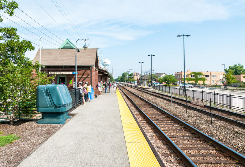 Passengers waiting for the train at the Northbrook Metra Station. stock image