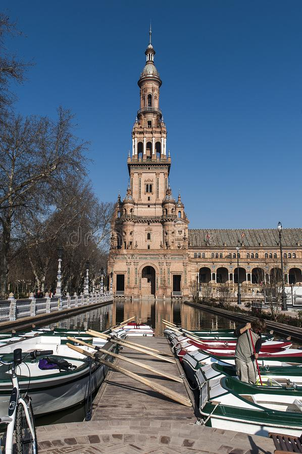 Northen Tower. Boats in fron of northen tower at Plaza de España, Seville, Andalusia stock photos
