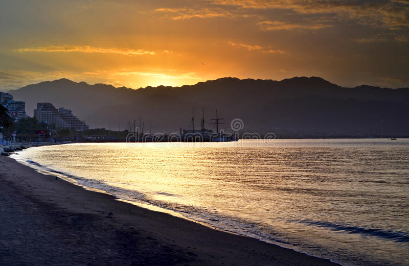 Northern beach of Eilat at sunrise, Israel. The shot was taken during a colorful sunrise on the northern beach of Eilat - famous resort city of Israel royalty free stock photography