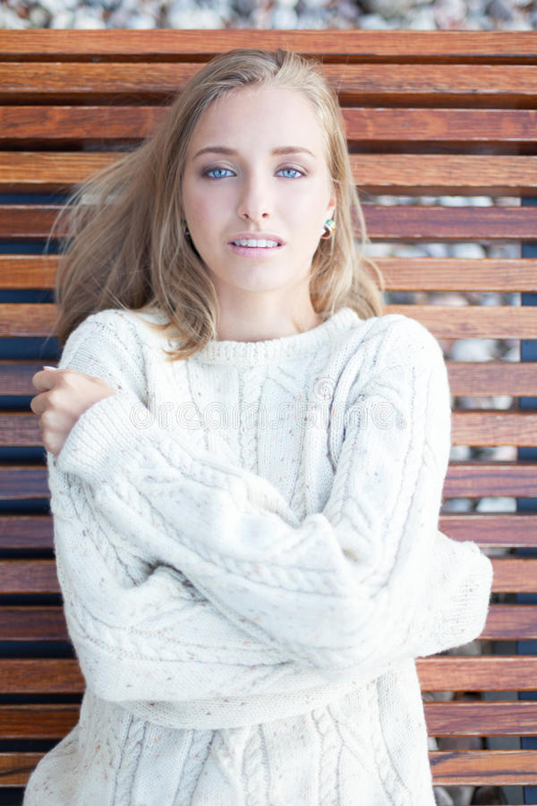 Northern beauty. Seductive woman freezing in sweater royalty free stock image