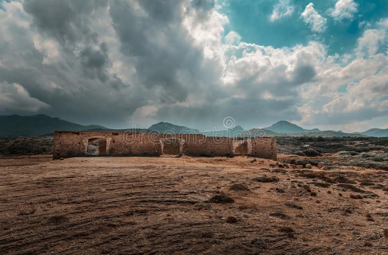 Northern Cyprus Karpaz landscape with ruins against a cloudy sky.  stock images