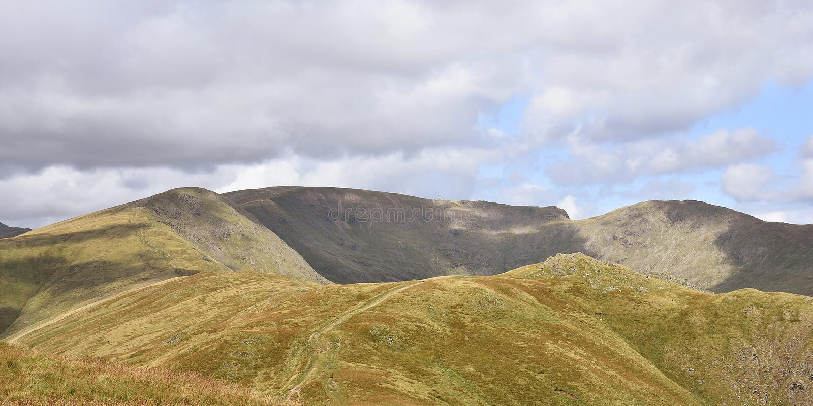 The northern end of Ambleside Horseshoe, Lake District. Panoramic of part of a popular walk, from Heron Pike area, Great Rigg, Fairfield then back over Link stock image
