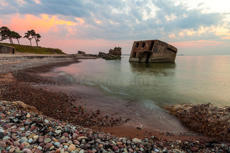 Northern forts after sunset. Remains of the Northern forts in water of Baltic sea in Liepaja, Latvia after sunset stock photo