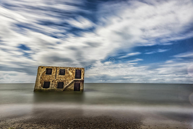 Northern forts in water of Baltic sea in Liepaja, Latvia. Sightseeing Object. Long Excposure photo shoot with ND Filter. Northern forts in water of Baltic sea royalty free stock photography