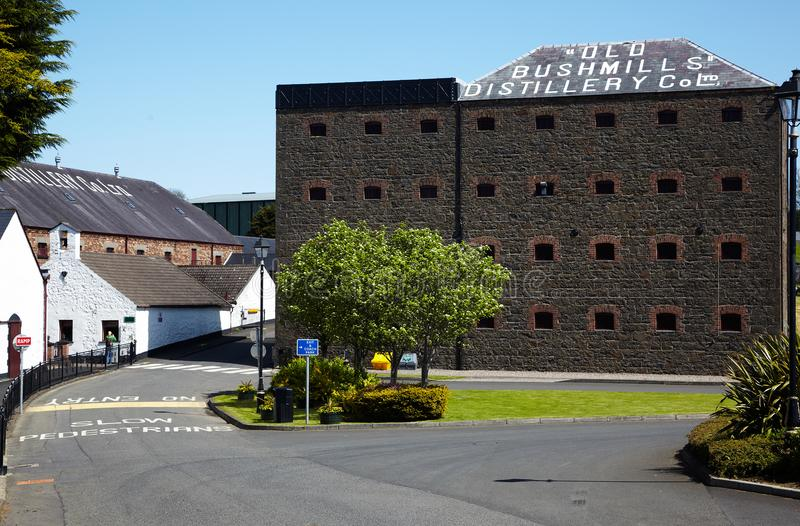 Old Bushmills Distillery. NORTHERN IRELAND - MAY 10, 2009: Old Bushmills grain alcohol distillery stock image