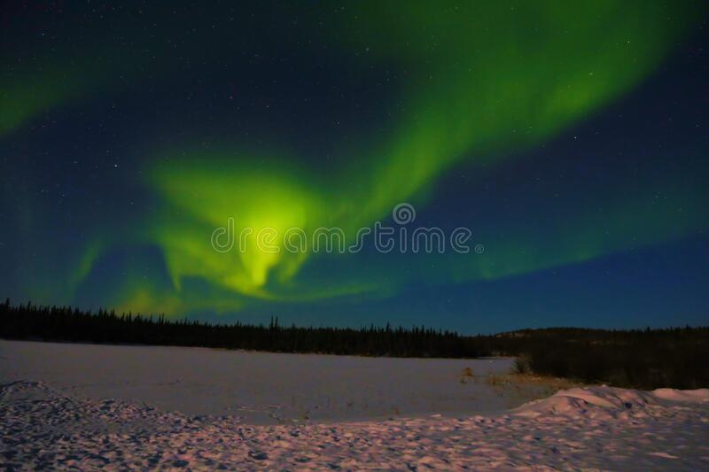 Northern light Aurora Borealis is dancing royalty free stock photo