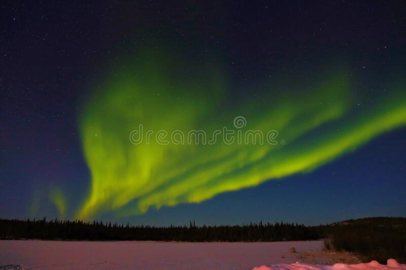 Northern light Aurora Borealis is dancing royalty free stock photography