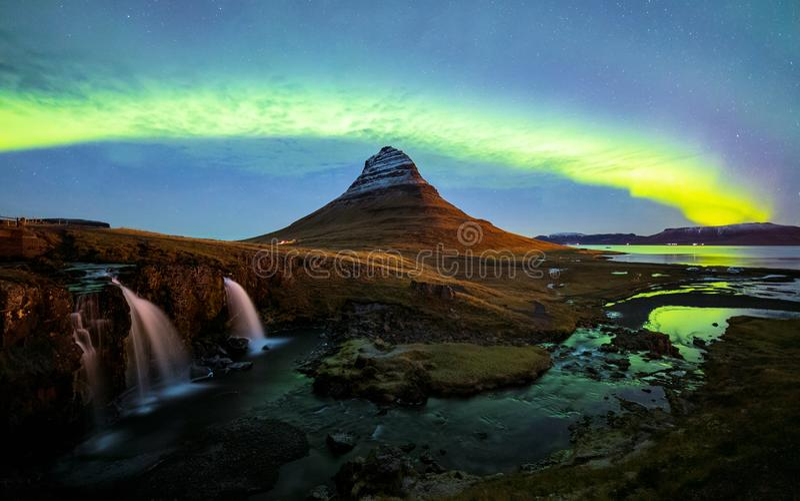 Aurora Borealis over Kirkjufell mountain in iceland stock images